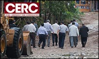 CERC design element over photo of men visiting disaster site