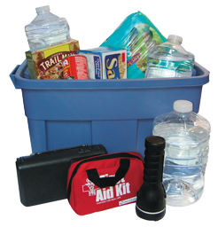 Large plastic bin filled with emergency supplies, like bottled water, food that won't spoil, a first aid kit, and a flashlight.