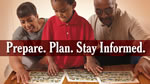Prepare. Plan. Stay Informed. - A family reviewing documents.